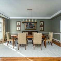 Formal dining room with modern light fixture, hardwood flooring, neutral paint, a butler's pantry and a tray ceiling. Listed in Oakton, VA for $1.6M byThe Casey Samson Team, a Wall Street Journal Top Team in Northern Virginia.