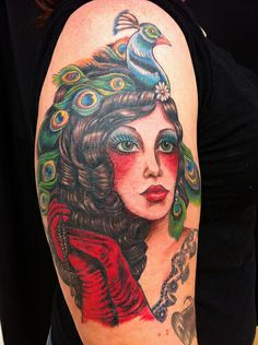 I don't know why I'm so obsessed with tattoos of women that are heavily made up and have peacock feathers on their heads lol