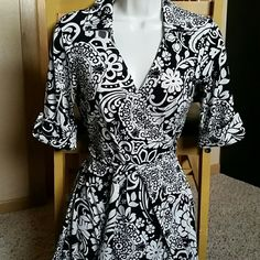 "NWT Ann Taylor Wrap Dress Pretty wrap Dress with collar and halfway between 3/4 and short sleeves. Approximately 39"" in length from shoulders. 94% polyester and 6% spandex. Very soft comfy material! Ann Taylor Dresses Midi"