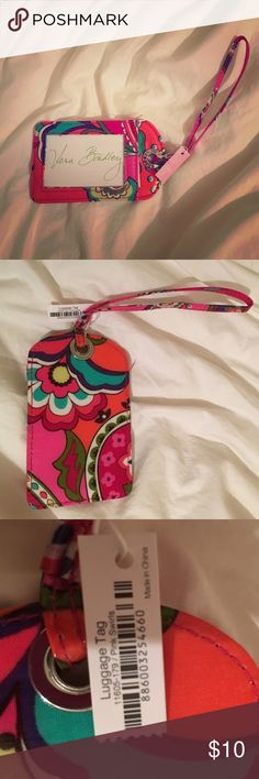 Vera Bradley luggage tag NWT NWT Vera Bradley luggage tag. Beautiful vibrant colors- pink, coral, red, orange, turquoise, purple. Never been used. Got it as a gift. Bundle for more discounts!  Vera Bradley Accessories Key & Card Holders