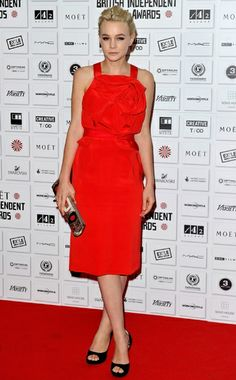 Carey and her smirk. Red frock from Prabal Gurung.