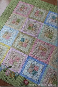 sweet baby quilt. i like the squares. i dont need all the fancy outside stuff but the squares with pinks blacks and purples would be adorable