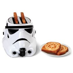 The Stormtrooper Toaster - Hammacher Schlemmer. Shaped in the form of the ubiquitous stormtrooper's helmet, the toaster simultaneously serves as a literal example and metaphorical icon of Imperial imprinting, yielding identically marked split buns, muffins, and waffles with an obediant fervor that never questions authority. Come to the dark side. We have toast. #backtoschool