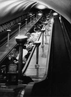 Londoners shelter from air raids in an underground station during World War II, 1940. (Photo by M. McNeill/Fox Photos/Hulton Archive/Getty Images)