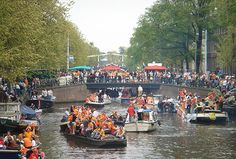 'Queensday' in Amsterdam. The 30th of April is a holiday in Holland. The birthday of our former queen, Juliana, the mother of Beatrix. Everybody dressed up in orange, which is the last name of our Royal family.