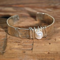 Silver Pearl Cuff Bracelet Wrapped in Sterling Wire. $85.00, via Etsy.