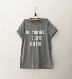 All you need is love and a cat tshirt for women white graphic tee funny printed top womens gift sassy cute tumblr fall winter back to school (Design is printed on front of the shirt and Sleeves are rolled up manually) ►Measurement ►Size XS - Bust 36 inches or 89 cm - Length 24 inches (from #funnytshirtsforwomen