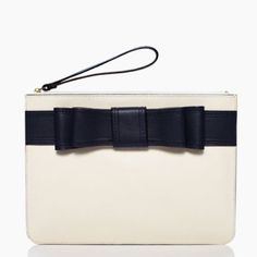 kate spade Georgie Clutch Wristlet 'Alice Court' brand new with tags kate spade Alice Court Georgie Clutch/Wristlet.  This beautiful Bag is Cream color with Midnight Blue bow on the front.  Zipper on top and small detachable wristlet loop  kate spade Bags Clutches & Wristlets