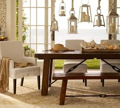 Farmhouse table and benches and upholstered chairs