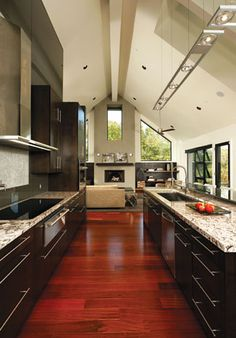 Open floor plan and high ceilings. Don't typically like so modern or a galley style kitchen but this works for me!