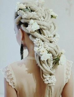 Gorgeous! Love the strings of pearl and flowers braided in with her dreadlocks! #blonde #White #Bride