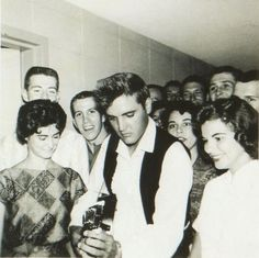 August 8, 1958 - Elvis (with his guitar) at the Western Hills Inn - Euless, Texas - just prior to his mother's death.  By many accounts, this was Elvis' favorite place to hang out while in the Dallas/ Ft. Worth area.