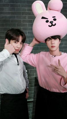 I'm dying bc of how cute jin looks inside of that crazy out fit but also bc jungkook aka my bias is also looking adorable❤❤