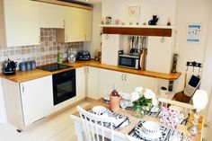 Excellent well-appointed cottage with panoramic sea views Holiday Accommodation, Isle Of Wight, Kitchen Cabinets, Sea, Interior, Home Decor, Decoration Home, Indoor, Room Decor