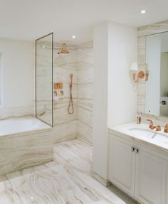 Marble and rose gold bathroom designed by Katharine Pooley.