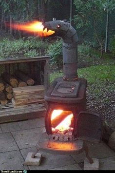 Fire-breathing dragon wood-burning stove for the back yard. we need one for the green dragons! Fire Breathing Dragon, Dragon Fire Pit, Dragon Head, Flea Market Gardening, Outdoor Spaces, Outdoor Decor, Rocket Stoves, Wood Burner, Outdoor Fire