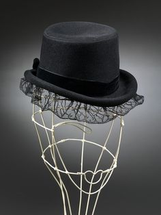 Hat | Elsa Schiaparelli (Italian, 1890-1973) | Made in Paris, 1938 | Materials: felt and lace | Miniature 'doll hat' in the form of a top hat, of felt with black lace brim. These small percher hats were one of Schiaparelli's trademarks | VA Museum, London
