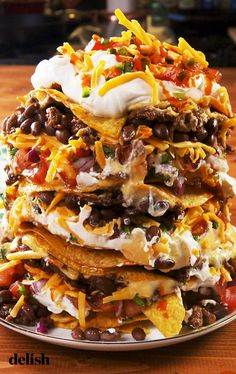 "Can Nachos If you've never made ""Trash Can Nachos"" you're SERIOUSLY missing out. Get the recipe at If you've never made ""Trash Can Nachos"" you're SERIOUSLY missing out. Get the recipe at Mexican Dishes, Mexican Food Recipes, Beef Recipes, Cooking Recipes, Mexican Trash, Nacho Recipes, German Recipes, French Recipes, Skillet Recipes"
