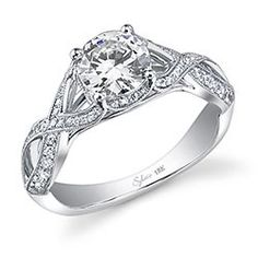 This dazzling white gold diamond engagement ring features a 1.00 carat round brilliant center with a total of 0.38 carats in a vintage crisscross diamond shank for a unique solitaire.