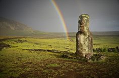 End of the Rainbow - A double rainbow forms at the lone moai of Hotu Iti, Easter Island.