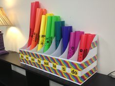 A few cardboard magazine boxes and some duct tape make a great Boomwhacker container!