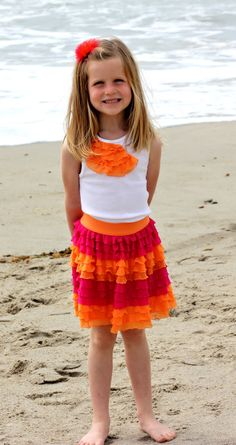 LOVE the ruffle fabric and absolutely LOVE LOVE the colors in this skirt.  Totally have to do this.