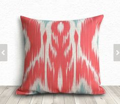 $14.99 https://www.etsy.com/listing/199681183/ikat-pillow-cover-pillow-cover-coral?ref=sr_gallery_1&ga_search_query=pillow&ga_order=most_relevant&ga_min=0&ga_max=60&ga_page=6&ga_search_type=all&ga_view_type=gallery