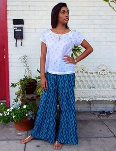 Wide leg, palazzo pants in an ikat aqua teal chevron print. These super comfy, chic pants feature a flat front waistband in the front and an elastic waistband in the back.