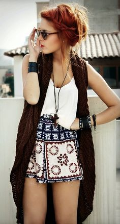 Spring: This girl's coloring and outfit both represent a spring tone. Her light skin and red hair work well with the dark brown vest. The dark blue in the embroidery also helps to complement her hair and skin tone.