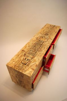 Can you read the fine print?  Try this technique on your OSB for a contemporary look.  The pop's of red really add something extra.  Risingbarn.com  #OSB #red #office #furniture #print #drawer #dresser #file #text