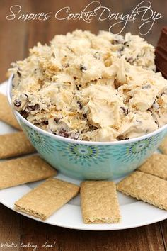 S'mores Cookie Dough Dip. Edible cookie dough dip packed with the flavors of smore's: marshmallows, chocolate, and graham crackers. A great dessert dip for any occasion. #dip #smoresweek