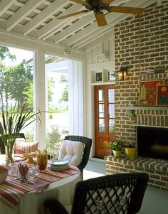I'd love to have a porch with an outdoor fireplace!