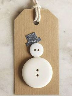 Make a button snowman Christmas gift tag. I love this snowman.