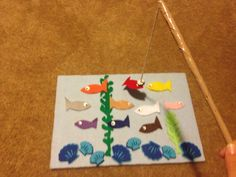 Felt/Magnet Fishing - super easy to make! Just cover a sturdy piece of cardboard with felt, decorate as you like (I went with the shells & seaweed), cut out felt fish & attach magnets for eyes on both sides of the fish. I used a white paint marker to give the appearance of eyes. Make a fishing pole using a thin dowel rod & sturdy string attached to a magnet. I covered the rod in beige duct tape & used super glue to attach the string to the magnet. My 20 month old son LOVES this game & it's a…