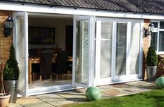 Seven pane, made to measure folding sliding bifold doors made from liniar, rehau , pvc and siegenia hardware