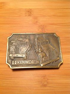 Kenworth semi truck plaque Vintage belt buckle by StewardsOfTime, $40.00 made by Bergamot Brass Works in conjunction with Tonkin, 1977
