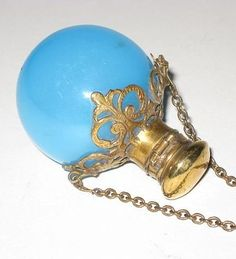 Antique vintage French blue cameo glass perfume scent bottle with brass fittings.