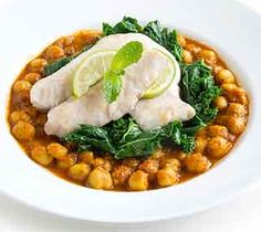 Baked Fish and Greens on Curried Chickpeas: A very tasty, easy to make, Indian-style fish dish you could serve with steamed basmati rice and mango chutney.