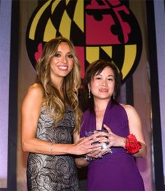 Mei Xu Receives 2009 Distinguished Alumnus Award from Philip Merrill College of Journalism. Mei Xu, creator and CEO of Blissliving Home and Chesapeake Bay Candle, has been honored with the 2009 Distinguished Alumnus Award of the University of Maryland's Philip Merrill College of Journalism. Fellow Alumnus Giuliana Rancic presents Mei Xu with her Award.