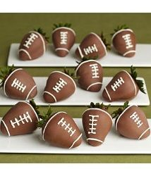 How cute are these chocolate covered strawberries that look like footballs. These are a must have for a football watch party or a kids birthday party! #football #football party #football party ideas #food #party ideas #sports @Erica Dennis