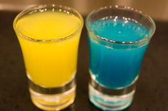 """Teleportation Shots (Portal Shots) First Shot2/3 shot Gold Tequila 1/3 shot Orange Juice Second Shot2/3 shot lime juice or Roses lime1/3 shot Bol Blue Directions: Take the first shot, immediately take the second shot. """"In laymens terms, speedy thing go in, speedy thing comes out."""" Shots made by Scrollbar.dk."""