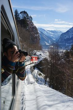 Winter activity: take a scenic train through the snowy mountains in Switzerland!