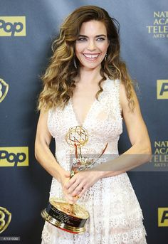 Amelia Heinle attends the 42nd Annual Daytime Emmy Awards - press room held at Warner Bros. Description from gettyimages.com. I searched for this on bing.com/images