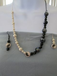 'OAAK Yin Yang Necklace and Earrings' is going up for auction at  1pm Sun, Jun 16 with a starting bid of $15.