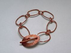 Bracelet by Sakina Brohier, Level 1 City & Guilds jewellery class. Copper oval links, hammered texture to the T bar clasp. Very precise links and elements. Lovely!