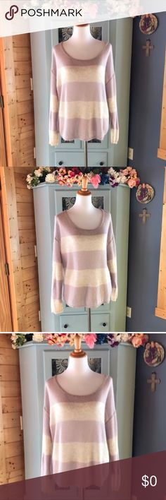 FREE PEOPLE OverSized Sweater. Lavender & Cream! WOW!😱!  Absolutely gorgeous!  And so SOFT!!  Perfect sweater for those chilly nights on the beach. Oversized style to it. Sweater has lots of stretch as well. Very well made. In excellent condition. No piling. Looks new. Super SOFT! Women's size Medium- accurate and still oversized. 40% acrylic, 35% nylon, 25% mohair. Washable. This is a very beautiful Sweater.  I'm open to reasonable offers on all items. You can use the bundle option for an…