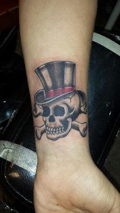 Traditional skull n top hat tattoo