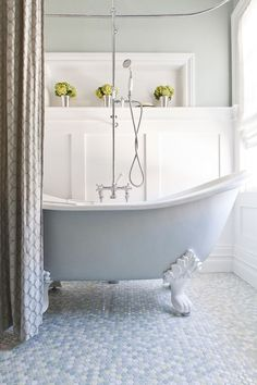 If you are lucky enough to own a claw-foot tub, make it the focal point of the room by giving the outside a coat of color, maybe chalky blue for a classic, serene look or soft petal pink for a romantic choice.