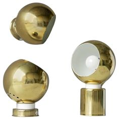 Three Magnetic Brass Ball Lights by Reggiani | From a unique collection of antique and modern wall lights and sconces at https://www.1stdibs.com/furniture/lighting/sconces-wall-lights/