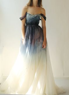 ON SALE - originally $4590 - Currently Over 25% off!  This gorgeous silk dress is perfect for a non-traditional bride.. Ivory silk organza gown with a fitted soft V neck bodice. The bodice is fully lined and structured with boning. The body of the dress has been dyed and hand-painted in a rigorous 9 stage process. The colors range from deep eggplant to amethyst to sapphire to mauve and sky blue radiating with the darkest point at the middle of the waist which is super flattering. The organza…